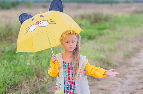 photo of girl holding umbrella checking for rain
