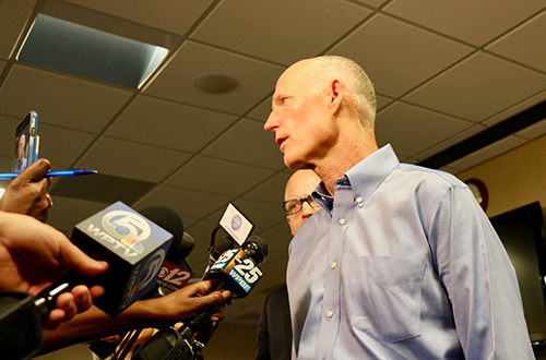 photo of Gov. Rick Scott at a press conference on addressing high water levels