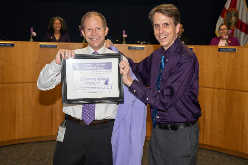 Chairman receives purple coat