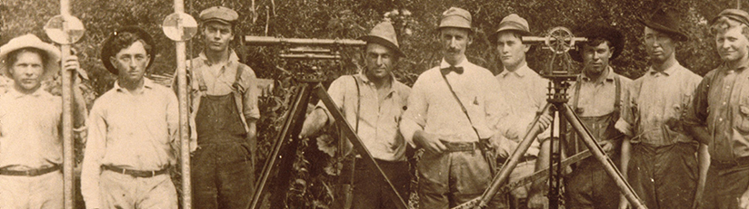 historical surveyors with their equipment